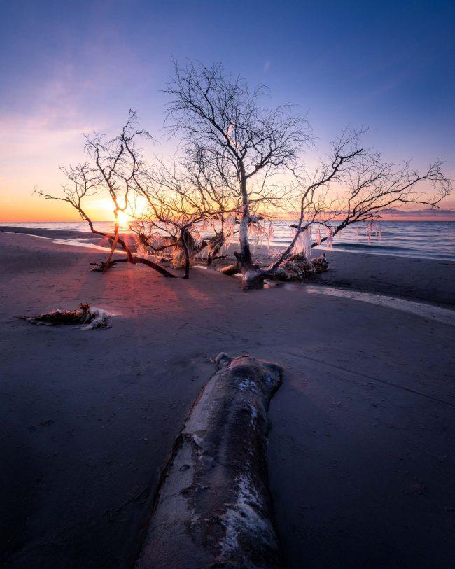 Der Weststrand im Winter zum Sonnenuntergang